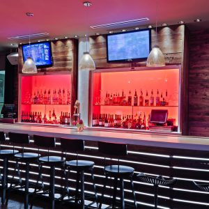 CANVAS Hotel Dallas full bar with seating