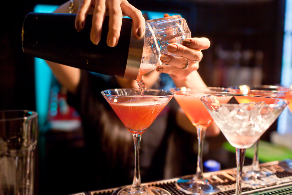 bartender pouring martinis