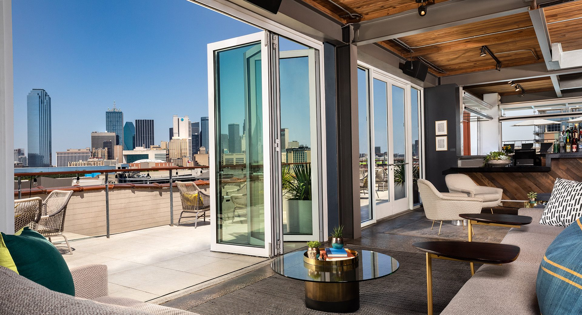 Gallery rooftop with lounge seating and outside view of Dallas Skyline