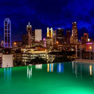 Canvas Hotel Dallas Rooftop at night with city view
