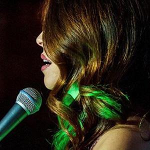 Elise Bishop Singing Into Mic