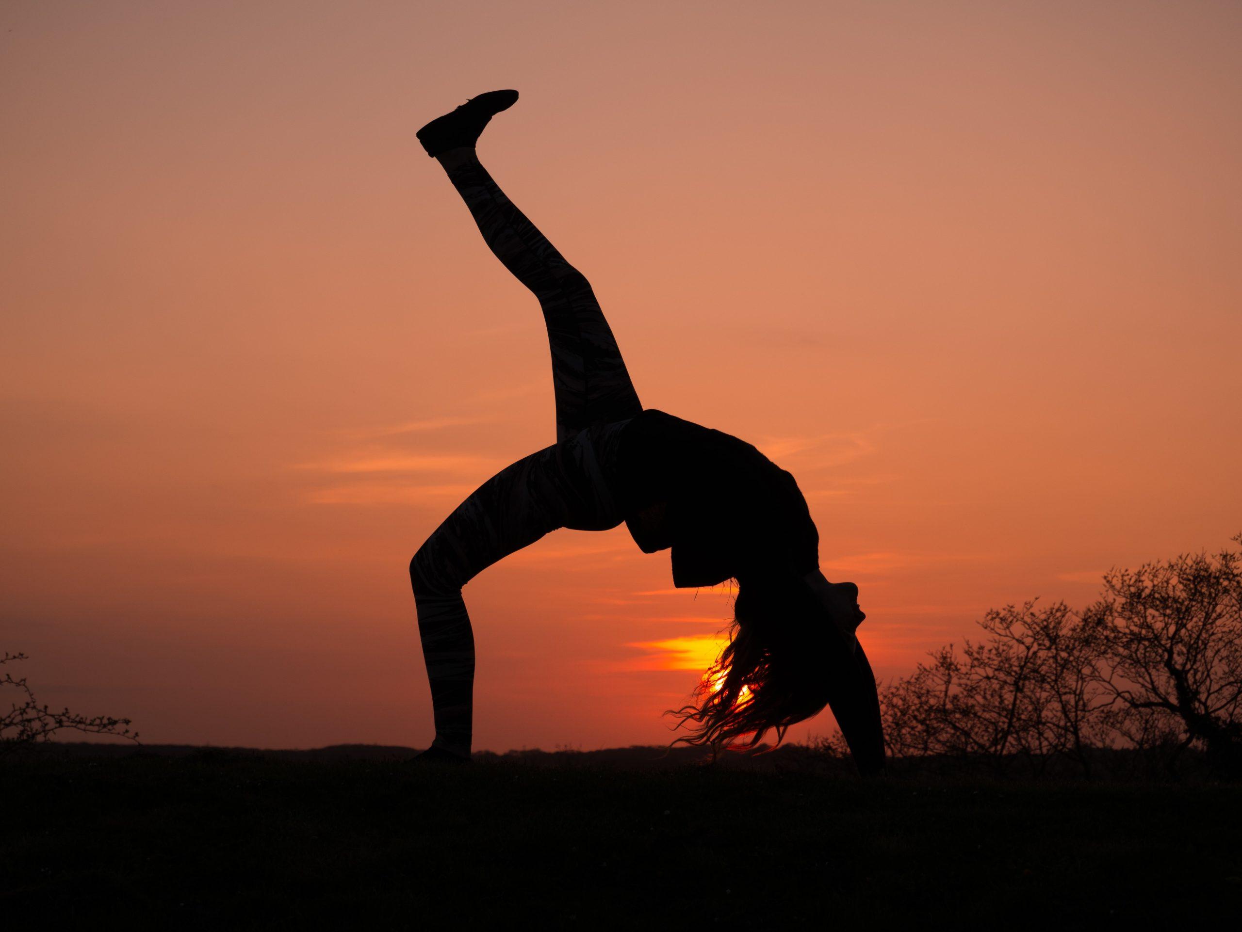 Girl Doing Yoga With Sunset